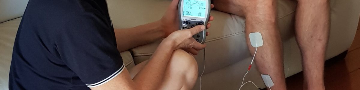 Your Home Physio Using Electrical Stimulation Unit on leg